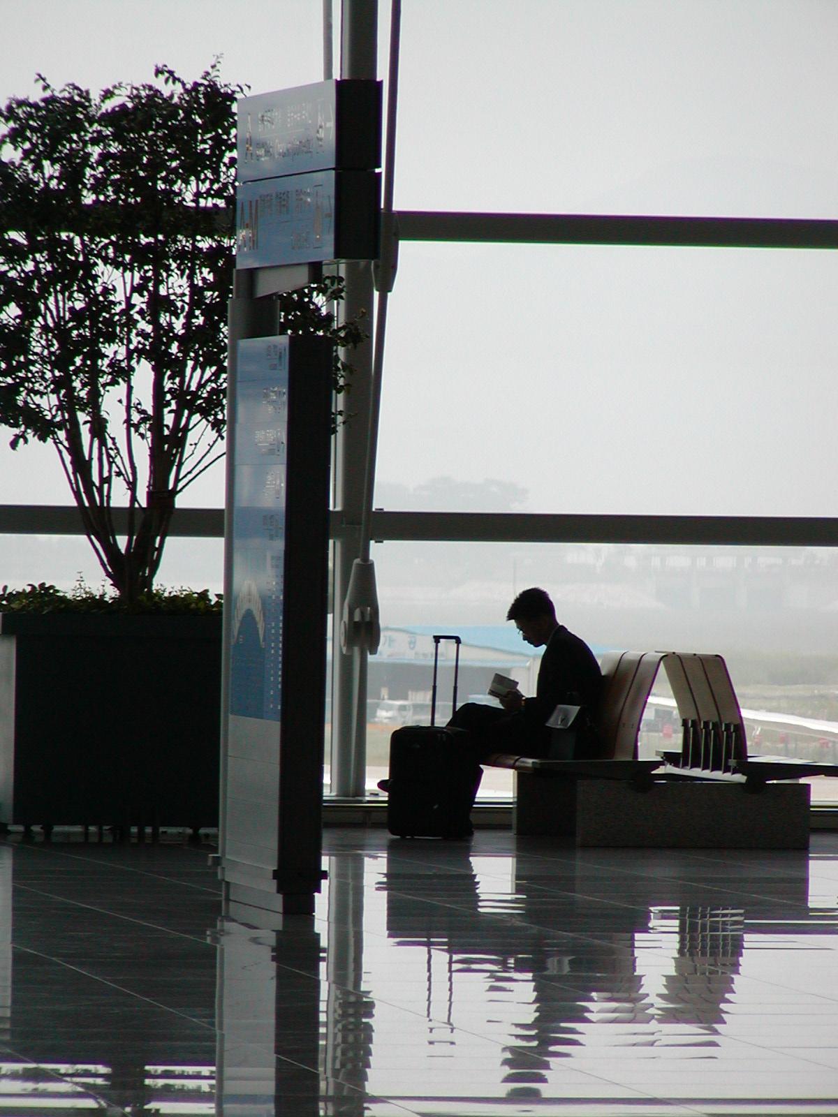 A man waiting in an aiport.