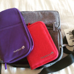 Photo of a document holder and travel wallet: two travel organization essentials.